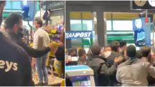 """بالفيديو/ بسبب """"كيس نيدو""""...تضارب في سوبرماركت بين أحد المواطنين ومجموعة موظفين!"""